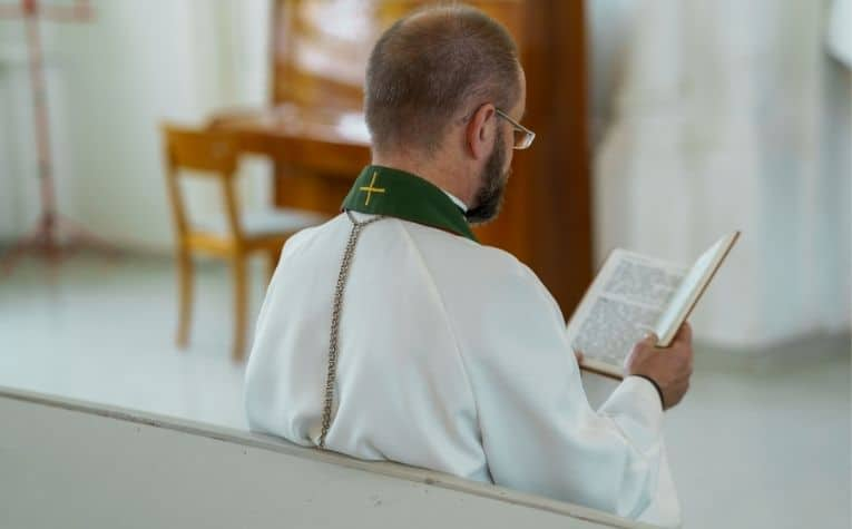 Lutheran priest reading a Bible