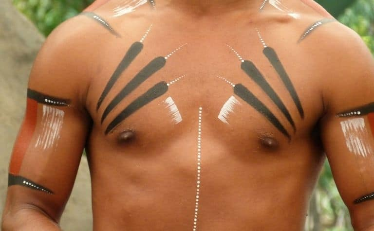 man with tribal tattoos